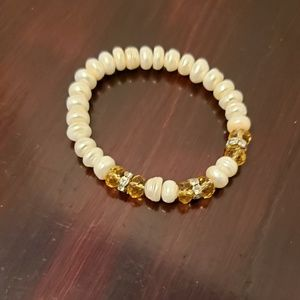 White and gold tone beaded layer bracelet